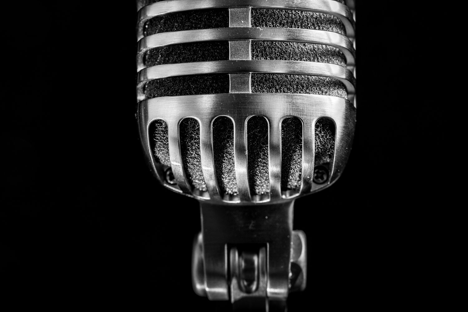 Vintage microphone on black background